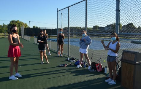 Tennis players apply hand sanitizer in between drills.