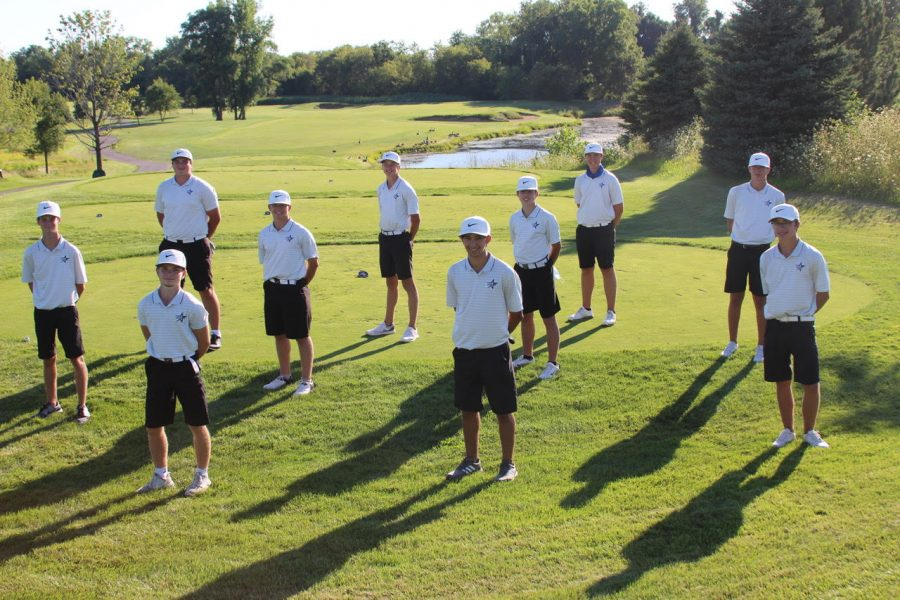 The boys golf team pose for a socially distant photo at one of their whole-team competitions.