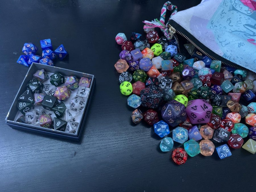 Above is a comparison of Caroline Look's 4 set dice collection as a novice player to her sibling's 50 set dice collection as an experienced player.