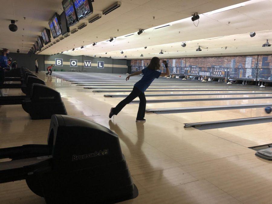 Varsity bowler Molly Denz bowls during practice at St. Charles Bowl.
