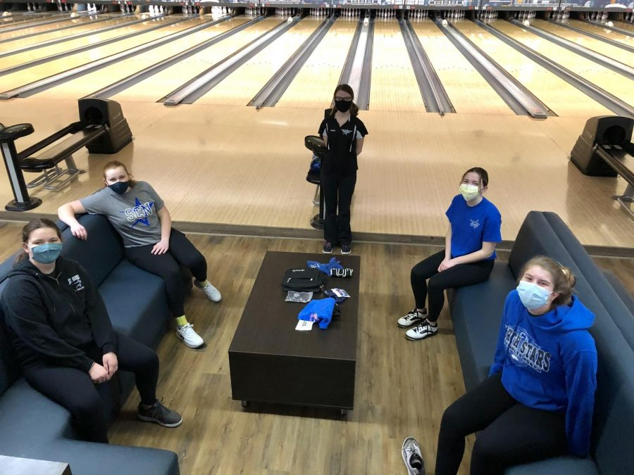 Bowlers practice while wearing masks and following socially distancing guidelines.