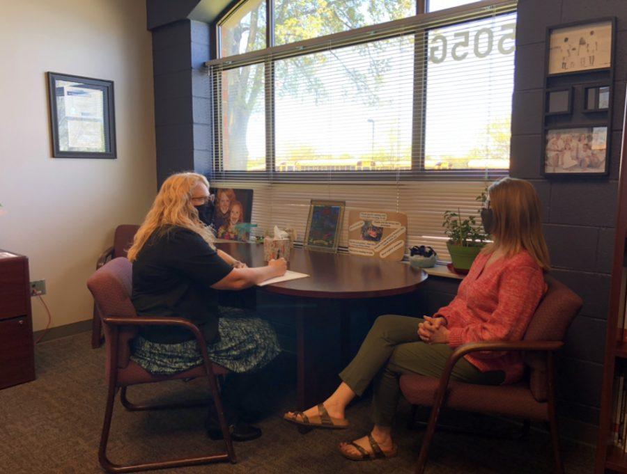 Christenson talks with Denise Leatherman, Business teacher