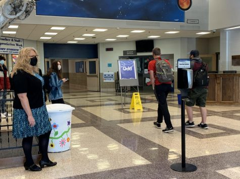 Christenson greets students in the foyer as they walk into school.