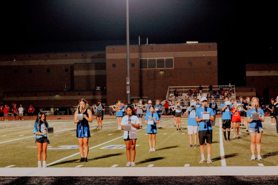 Band members watch the Drum Major as they play through their song list