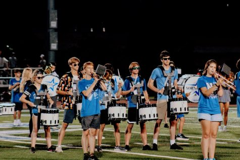 The marching band plays on the football field for the first time in two years