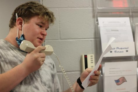 Ben Swanson reads the morning announcements.