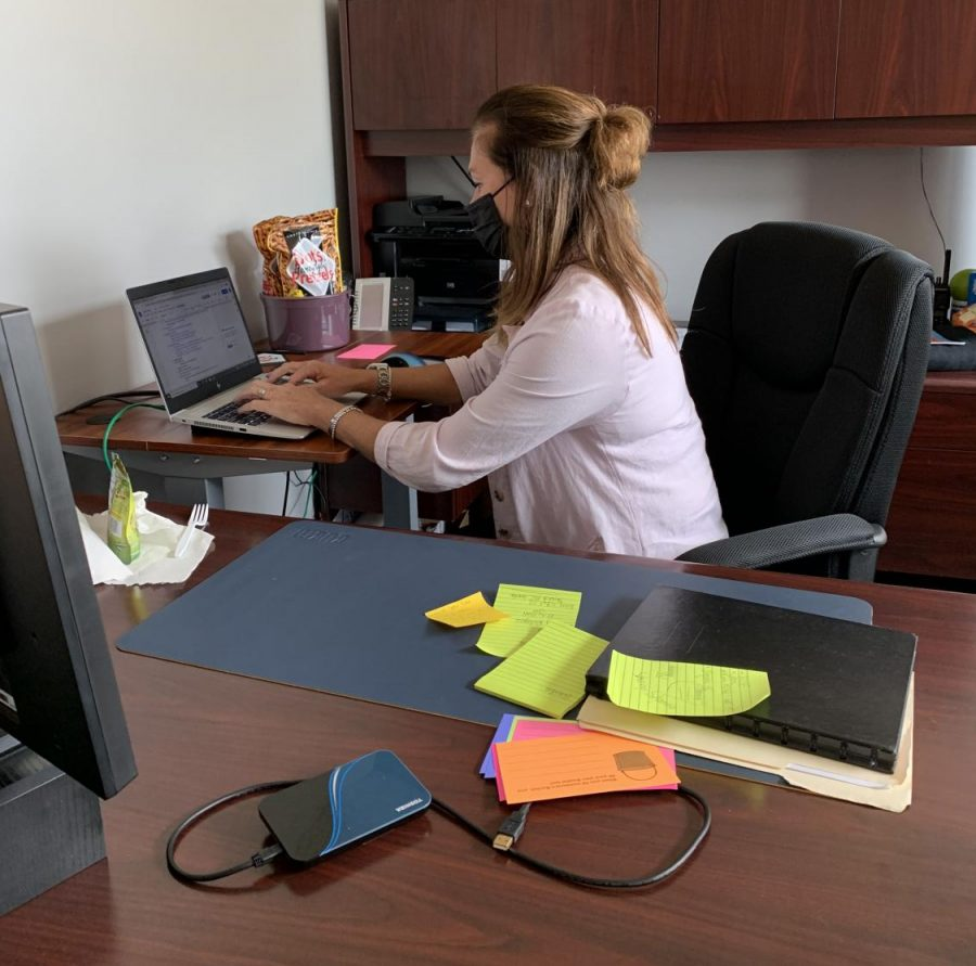 Lewis working at her desk