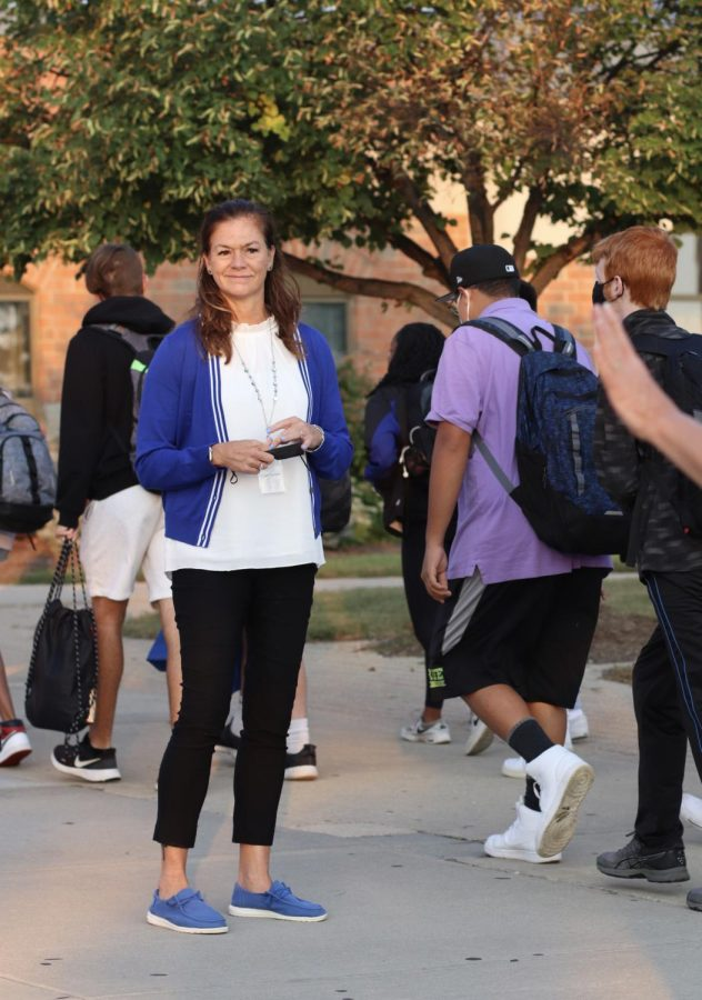 Lewis greeting students as they walk into school