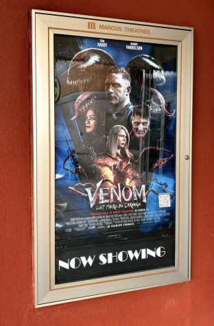 A movie poster displaying Venom: Let There Be Carnage